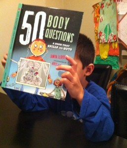 Kyi's son checks out the new book on anatomy