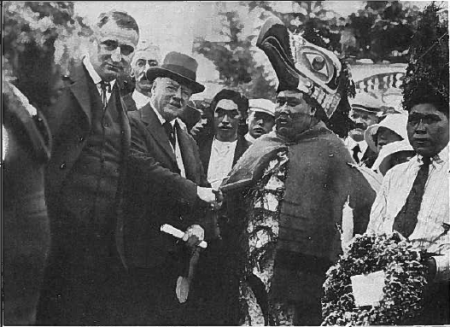 Lieutenant Governor W.C. Nichol greets Chief Napoleon Maquinna outside his home. Second from left facing camera: Victor B. Harrison representing the Native Sons of British Columbia. 4th from left: Tom Deasy, interpreter. Photo by Lemm Roos.