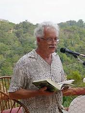 Deverell, William reading at microphone