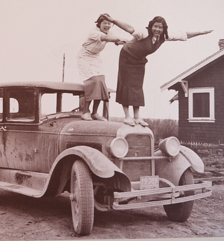 Margaret and Helen Stone on hood of car.