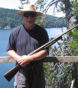 Cox, J. David with rifle