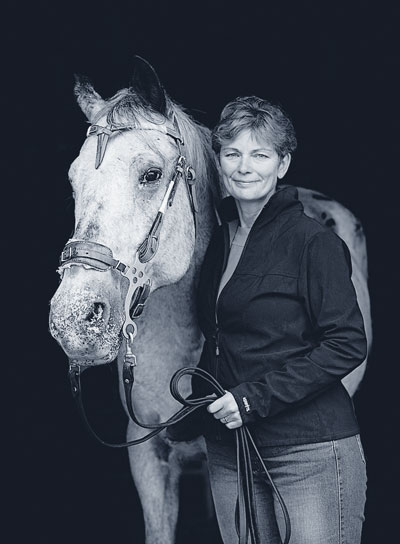 "Julie White with Keno. In 2015, she wrote, ""We took a gamble and bought him at our local livestock auction. Except for a thereabouts age of seven, nothing was known of his history. He's now 25 and pretty much retired to pasture after a long and useful career that spanned the horse show ring to the racetrack where he ponied our racehorses to the starting gate."""