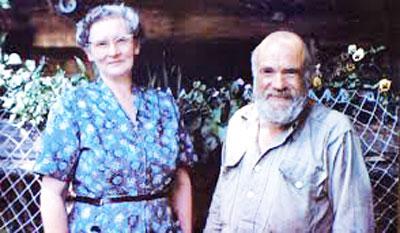 Edwards,-Ralph_Ethel-and-Ralph-&-flower-garden-WEB