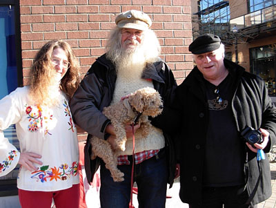 West Coast poets chilling on Commercial Street in downtown Nanaimo Kim Goldberg, Tim Lander with dog, and Jamie Reid.