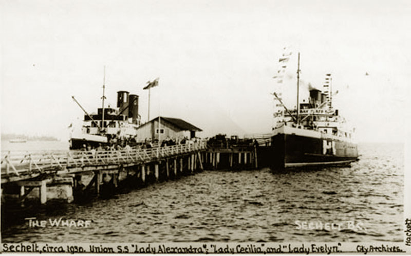 Union Steamship Company vessels, The Lady Cecilia and the Lady Evelyn docked at the wharf in Sechelt, circa 1930s.
