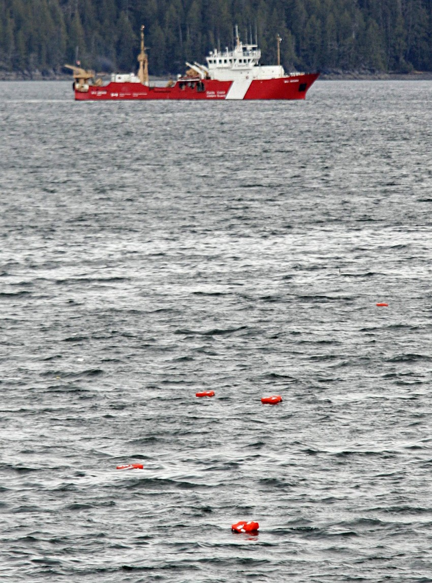 Lifejackets from the B.C. ferry Queen of the North, float in the waters of Wright Sound while the Canadian Coast Guard vessel W.E. Ricker continues with a search of the waters near Hartley Bay, B.C., Wednesday, March 22, 2006. Passengers on the overnight B.C. ferry were torn from their sleep Wednesday morning and thrown into a living nightmare, evacuating onto lifeboats that tossed and swayed on stormy seas for more than an hour as the Queen of the North disappeared into the Pacific.(CP PHOTO/Richard Lam)